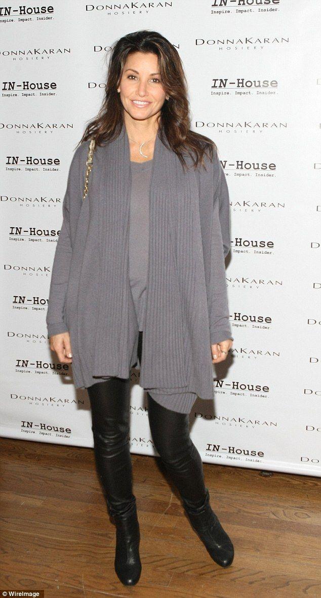 Gina Gershon, 50, in black leather pants