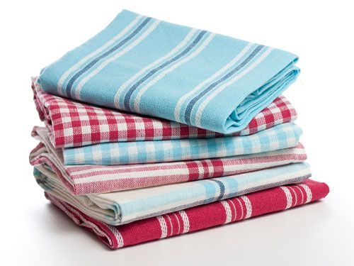 Reader Trick, Buy dish towels and table cloths on sale; then clip them for window coverings. WomansDay.com