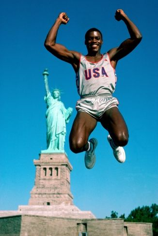 Neil Leifer's 1984 Olympic Odyssey Around the World - athletes in front of famous landmarks - Carl Lewis jumps in front of the Statue of Liberty