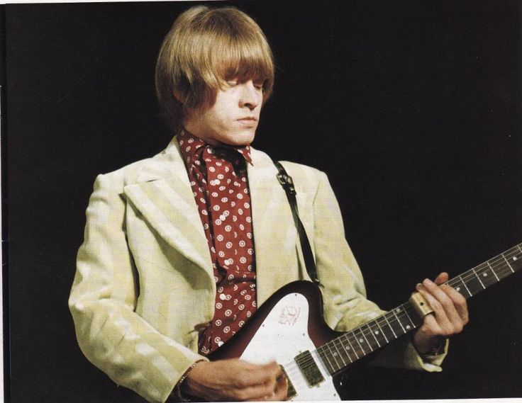 Brian JOnes of The Rolling Stones, rocking out on a #Gibson Non-Reverse Firebird.  If you fancy one, check our link!  #TheRollingStones #guitar