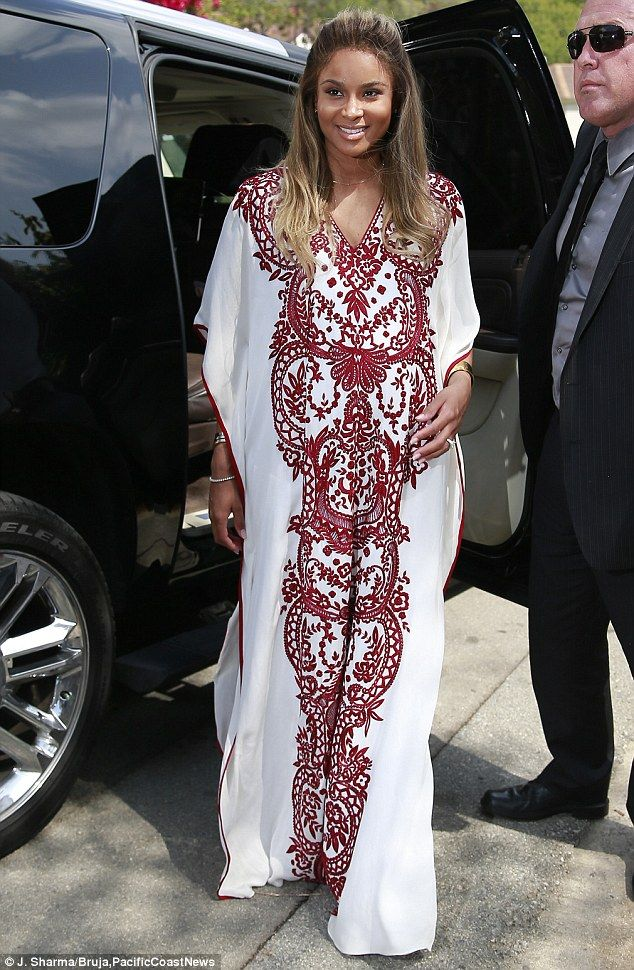 Guest of honour! First-time mom-to-be Ciara was radiant in her floor-length white kaftan, which featured a striking deep scarlet Moroccan-in...
