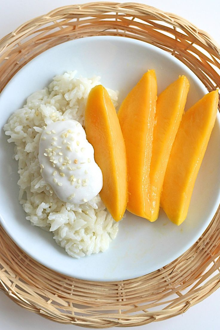 Mango Sticky Rice - a traditional Thai dessert of sticky rice that's been soaked in a lightly sweetened coconut cream with fresh mango on the side.