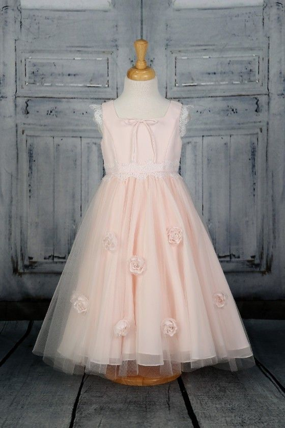 ad4c262567e The prettiest flower girl dress with soft tulle skirt decorated with  handmade flowers