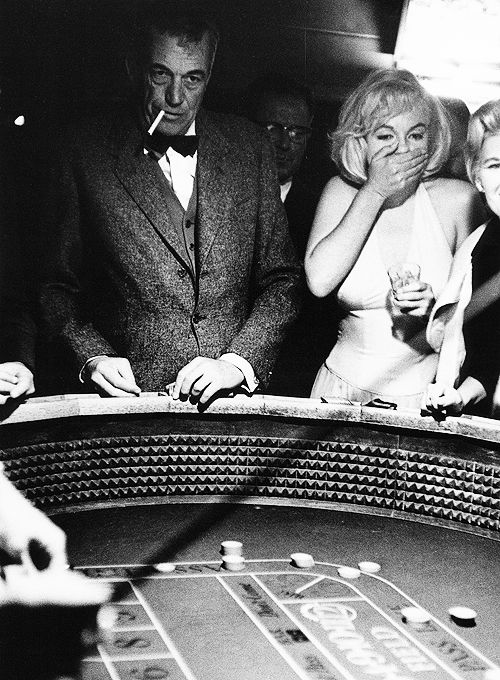 """While filming """"The Misfits""""  in Nevada, film director JOHN HUSTON taught MARILYN MONROE how to gamble.  1960"""