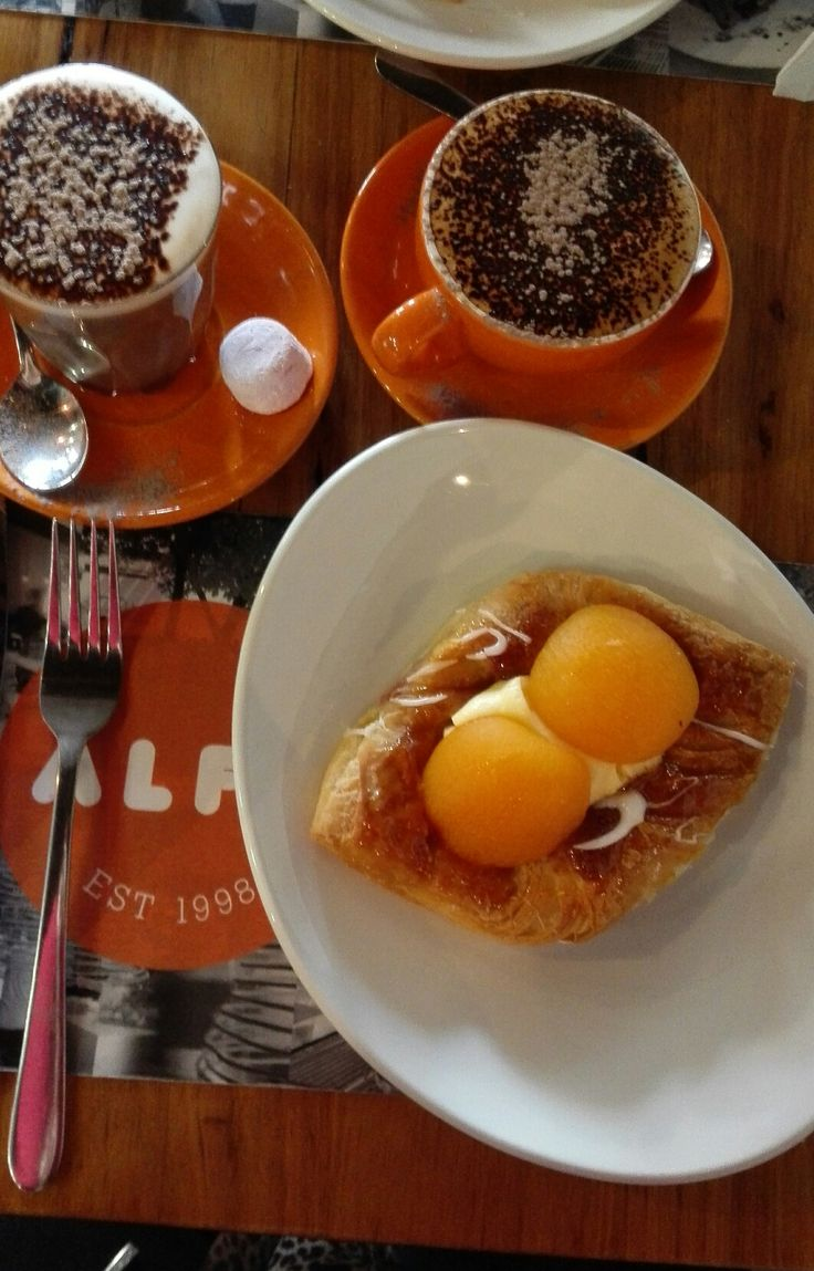 Cappuccino and hot chocolate with Danish apricot at Alfa Cafe Yarraville