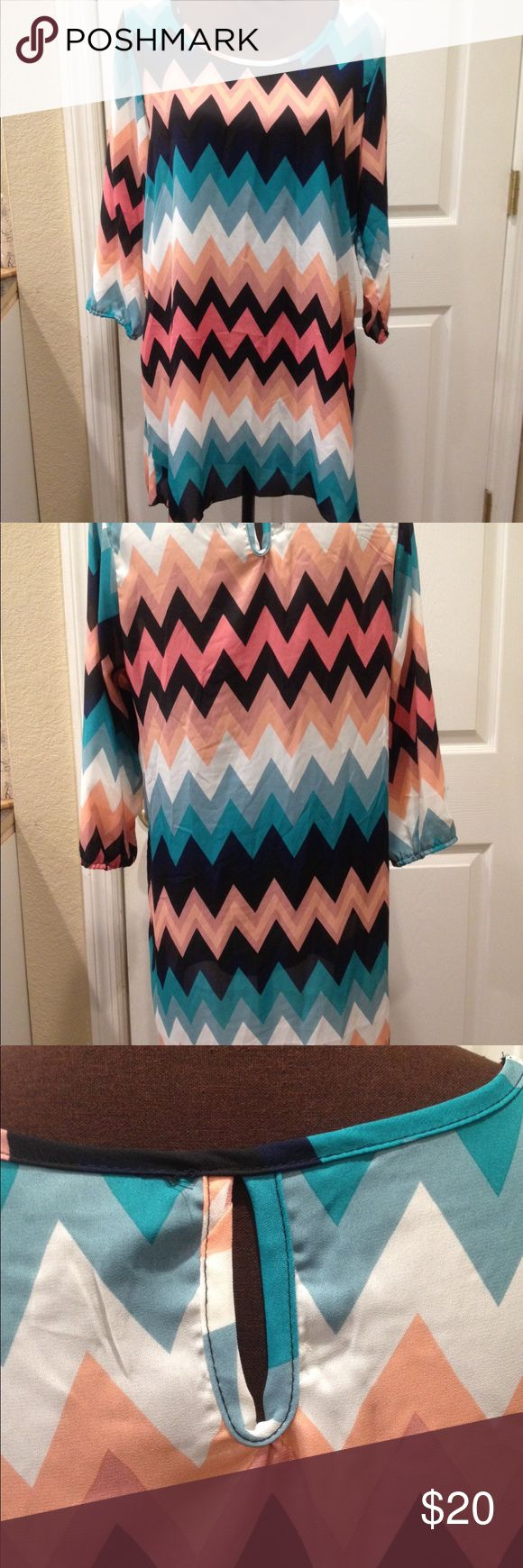 "Rue 21 long sleeve multi colored chevron top. Like new Rue 21 long sleeved multi colored chevron top with small key hole back at the neck and belt loops on sides. 100% polyester. 21"" arm pit to arm pit and 31"" length of back. See photos for details. From a smoke free home. Rue 21 Tops"