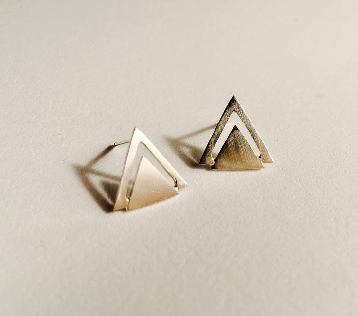 Sterling silver triangle earrings. $25