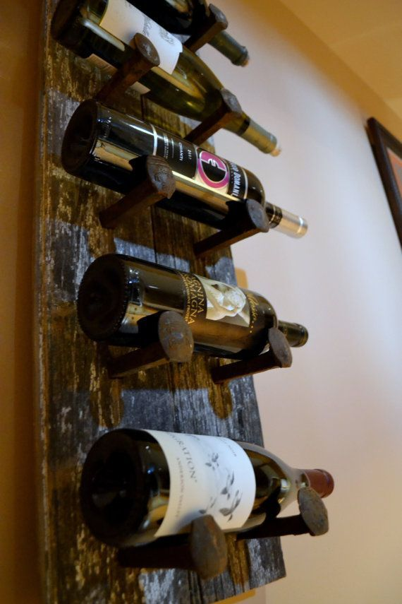 Sooo glad to find this! I was just trying to figure out an out-of-the-ordinary way to line the area above my cabinets with wine bottles! Barn Wood  Railroad Spikes Wine Rack