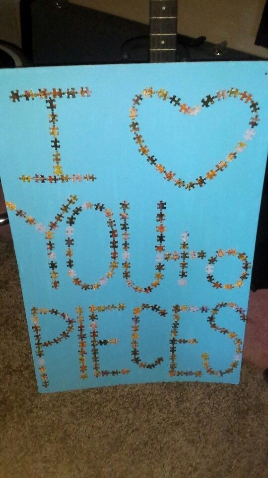 I did this for me and my boyfriend's 6 month anniversary, I had a puzzle that I didn't like so I never made it and I used those pieces for the letters. For the actual canvas I used a thick foam poster board and painted it blue. After it was done drying I put the pieces on with a hot glue gun (normal glue won't work with puzzle pieces)