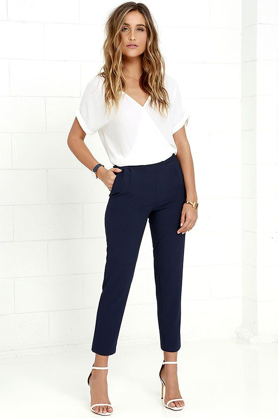 When you're not busy conquering the conference room, kick back in the Kick It Navy Blue Trouser Pants! Sleek woven poly constructs…