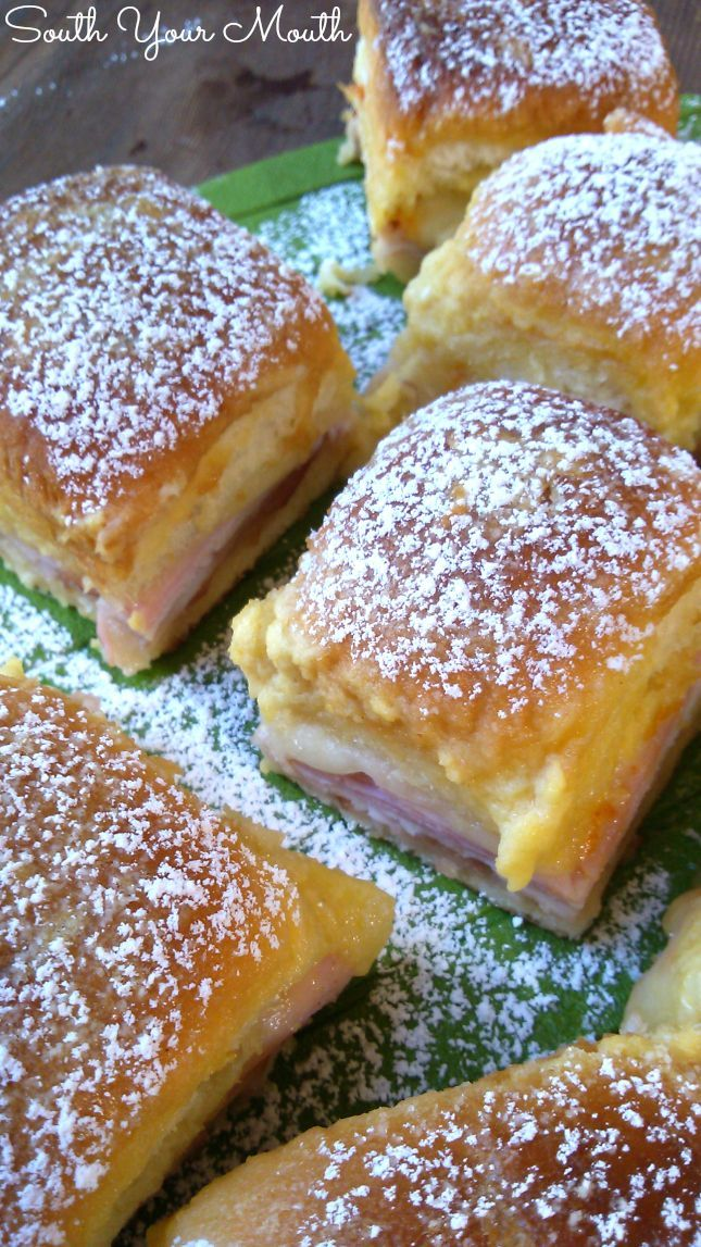 Monte Cristo Party Sliders! Sweet Hawaiian rolls, turkey, ham and cheese baked in a rich buttery topping dusted with powdered sugar. Sweet and savory goodness!