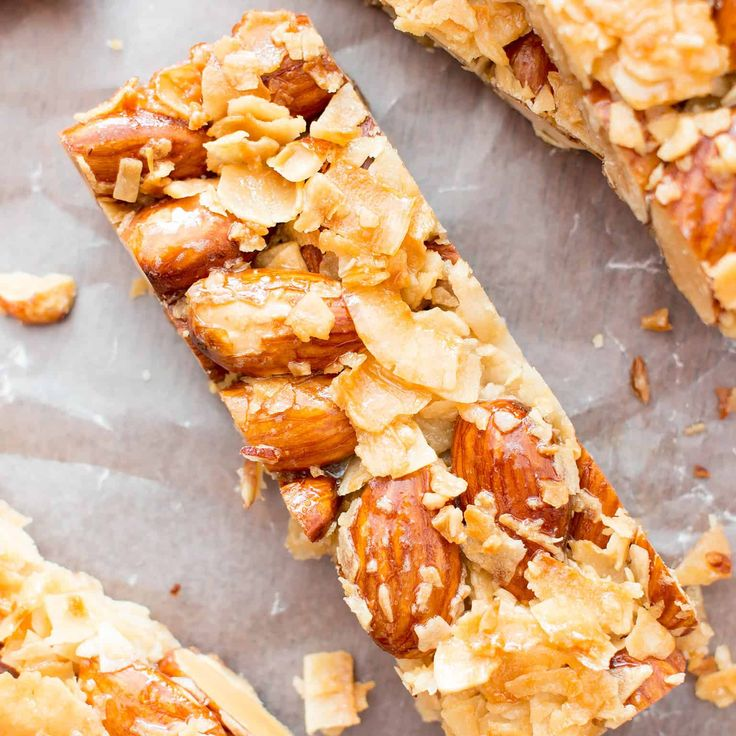 3 Ingredient Homemade KIND Coconut Almond Bar Recipe (V, GF): an easy recipe for homemade paleo KIND bars packed with crunchy almonds and sweet coconut.