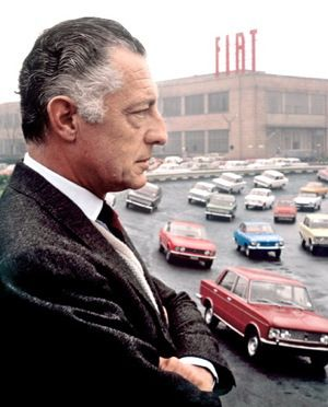 Gianni Agnelli at the test track atop the Lingotto building at Fiat headquarters, Torino, 1967. Behind him are the latest Fiat production models including the 125 Berlina, Dino Coupé and 850 Coupé Sport. Photo: Magnum