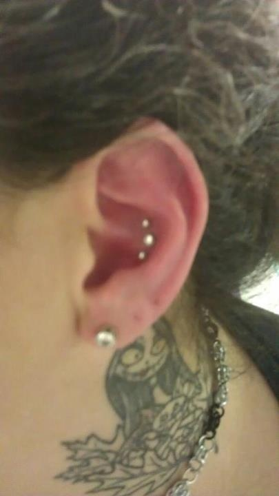 NOT the tattoo...that's a little freaky, but the triple conch piercing is cool :)
