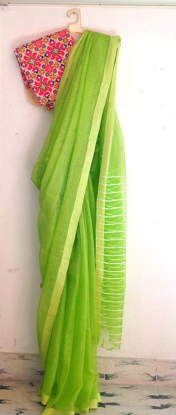 Lime green semi tussar silk saree with kutch work unstitched blouse