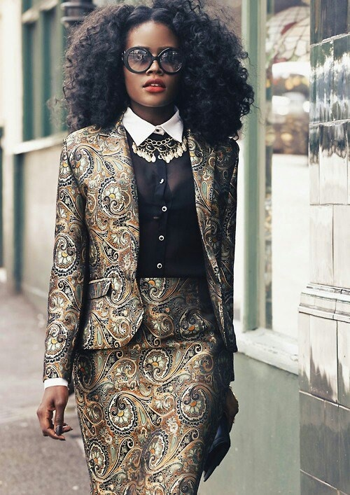 OMG! There's NOTHING about this look not to like. #brocade gold & black suit + big black sunglasses + red lips