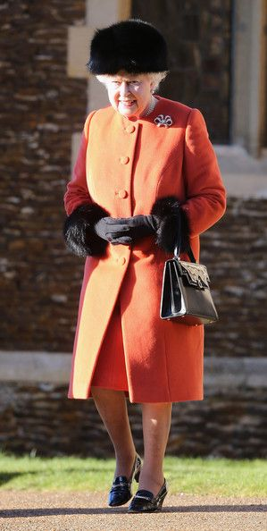 Seasons Greetings...Queen Elizabeth II accessorized her orange coat with fur-trimmed gloves and a hat as she attends the Royal Christmas Service events 2013