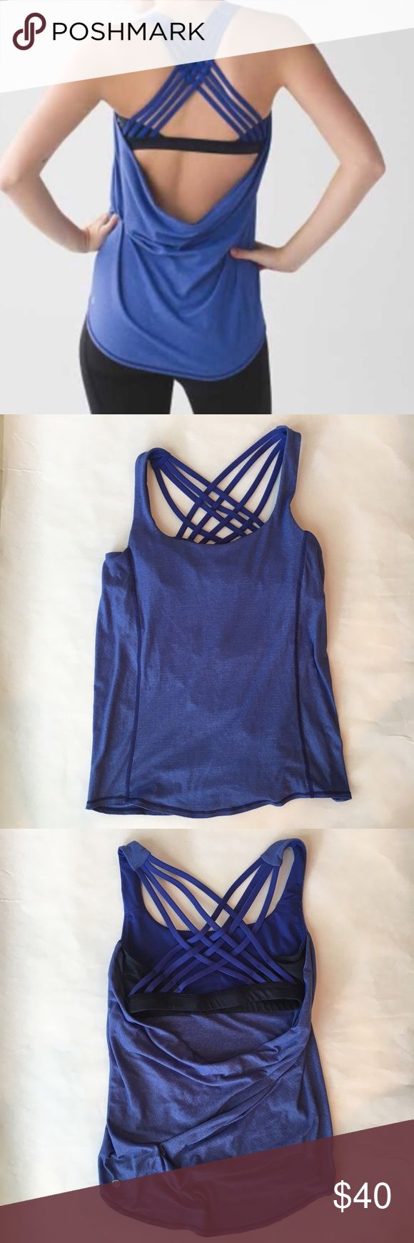 Lululemon Wild Tank, strappy and drapes in back Wild Tank style sold out on lululemon.com Beautiful heathered blue top drapes in back to show built-in bra in black and blue camouflage pattern Size dot in left cup-insert pocket EUC lululemon athletica Tops