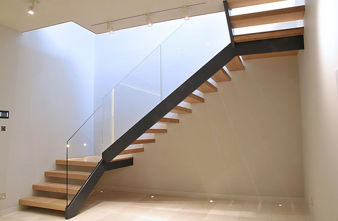 This simple and cost effective stair was constructed in powder coated mild steel carriage, toughened glass balustrade and hardwood timber treads.
