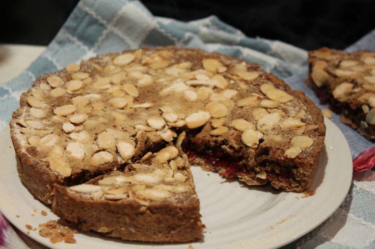 Vegan bakewell tart with homemade raspberry jam