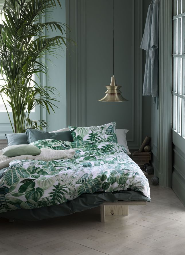 Love the way the botanical bedding is brought to life by the house plant and the green walls. The copper light is the perfect finishing touch for this botanical bedroom.