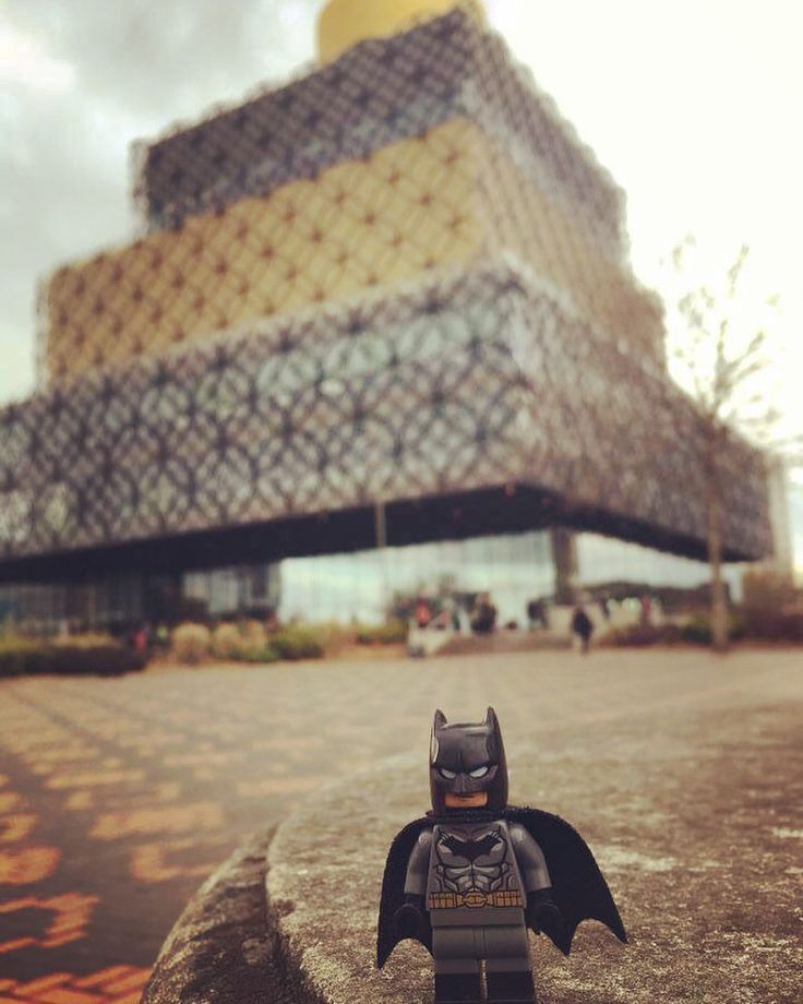 Batman loves a good library. You can see how delighted he is.