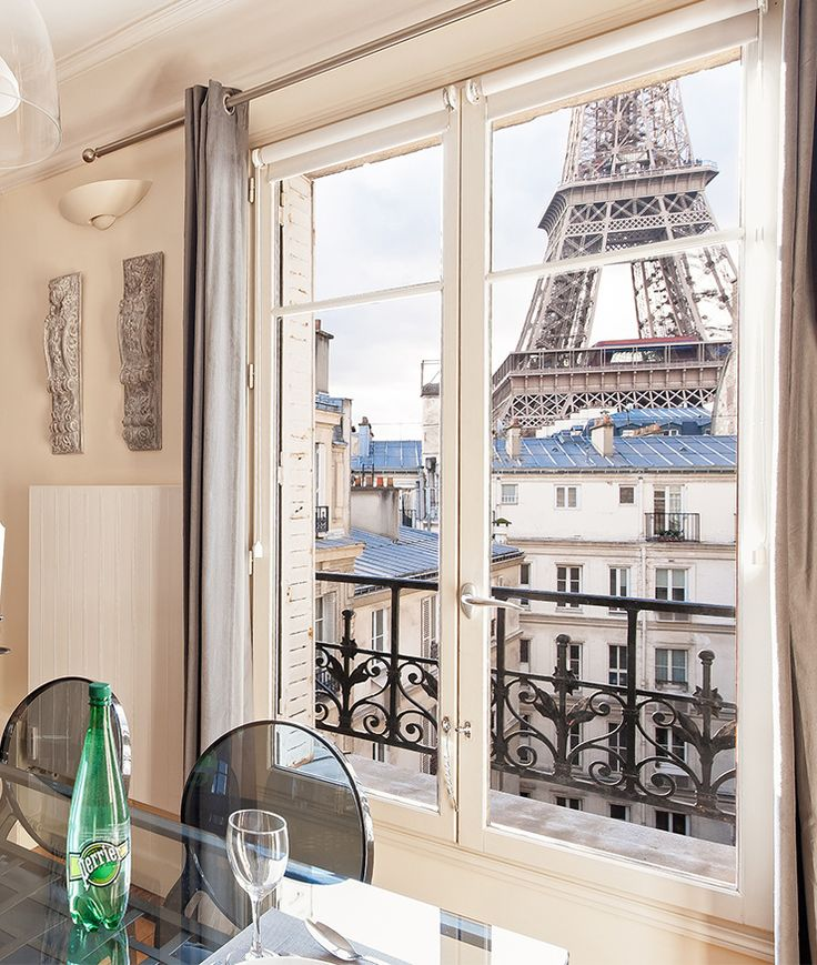 Sparkling water with a side of Eiffel Tower, anyone?! Rent this apartment on your next trip to Paris, the 2-bedroom Romanée. | Paris Perfect