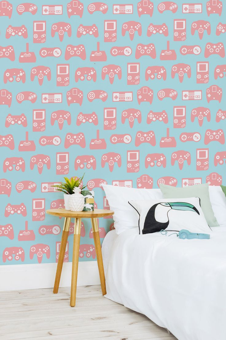 On the lookout for creative bedroom ideas? This retro gaming wallpaper exudes creative flair and brings the fun of gaming to your walls. Colourful illustrations of famous gamepads over the years makes for a playful yet stylish design for your home.