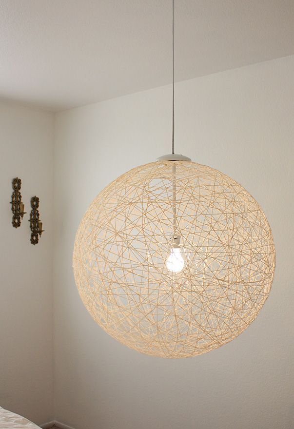 Here's a yarn light I think would be cool. You could use a different color too. I liked how they didn't just use the wire to dangle down into it but instead put a rod on it. I think I makes it look nicer than the doily one.