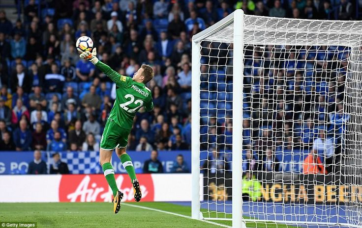 Liverpool goalkeeper Simon Mignolet is at full stretch to tip Marc Albrighton's header over the bar before half-time