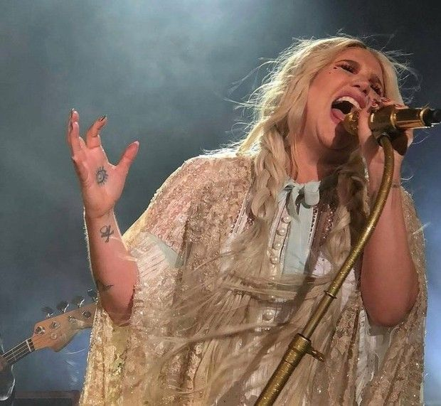 """Kesha kicked off her """"Rainbow Tour"""" on Sept. 26 at Iron City in Birmingham, performing tunes from her first album in five years and unleashing a torrent of confetti at the entertainment venue in Southside. The sold-out show drew about 1,300 people, many of them adorned in glitter as a tribute to their favorite electro-pop artist."""