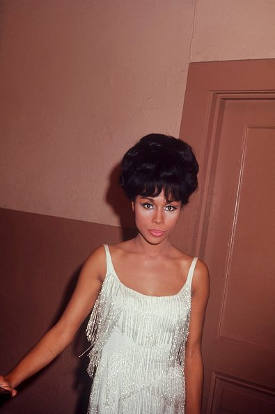 Diahann Carroll in a hallway wearing a white dress circa 1970 New York