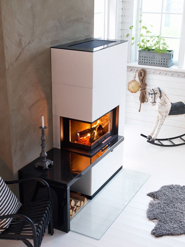 The Contura i41A fireplace has an angled door and is clad in artstone. #fireplace #contura