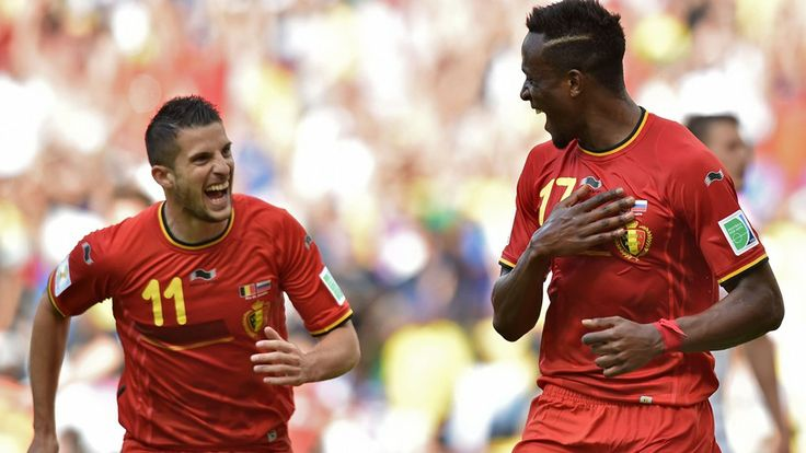 Belgium's forward Divock Origi (R) celebrates after scoring with Kevin Mirallas