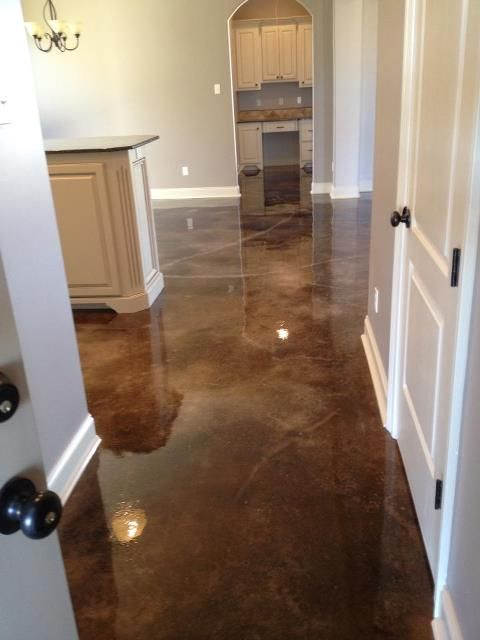 Gorgeous stained concrete floors by Old World Concrete Design in Louisiana - great for a basement!