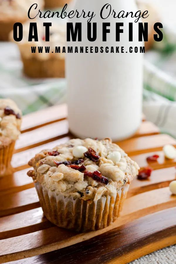 Cranberry Orange Oatmeal Muffins topped with an oatmeal streusel, dried cranberries, and white chocolate chips. Perfect…