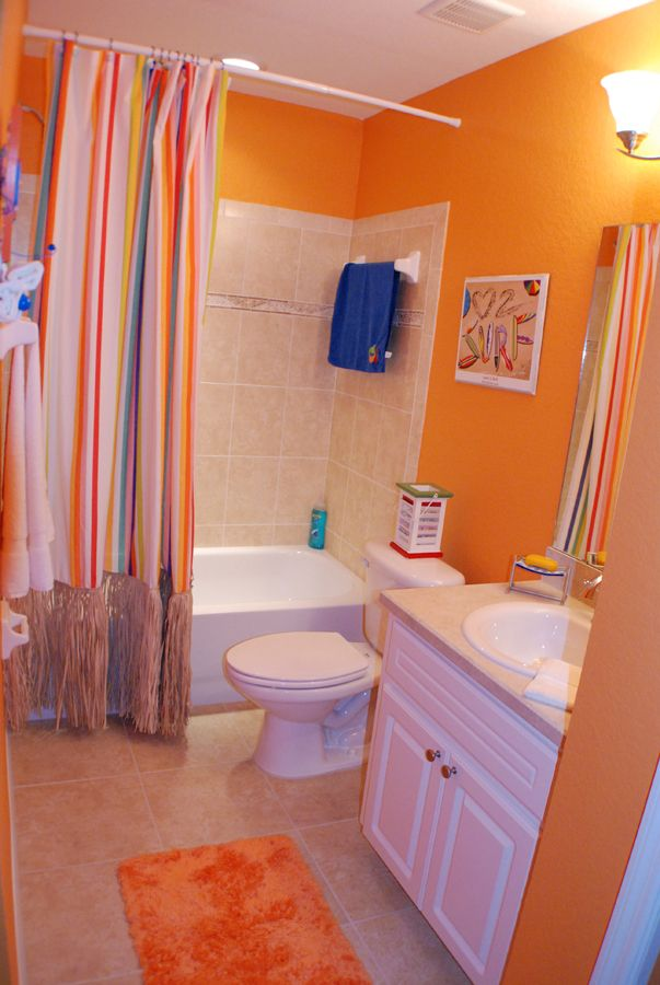 what do you think of this daring orange bathroom