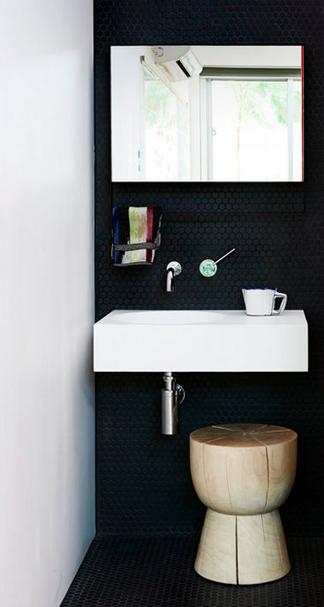 Cool use of black penny round tiles!