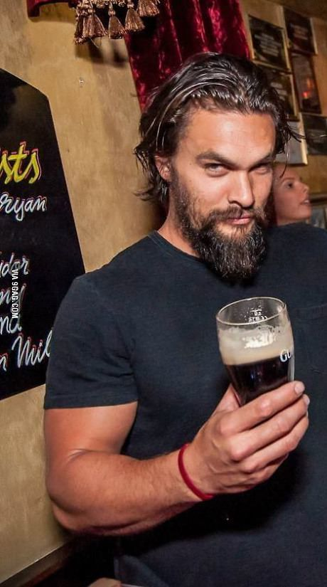 Jason Momoa, holding a beer and giving THAT look.