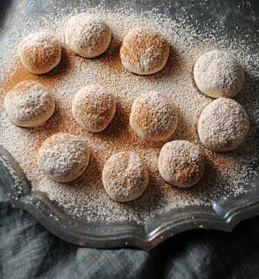 Polvorones-Polvo is Spanish for dust and these tender cookies known as Polvorones are dusted with loads of sugar and cinnamon.Quick and easy, these are traditionally served at weddings, enjoyed throughout the holiday season and made for Las Posadas the nine day Mexican celebration which reenacts Mary and Joseph searching for shelter in Bethlehem.