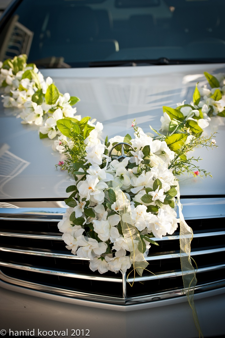 Floral decoration on brides car..