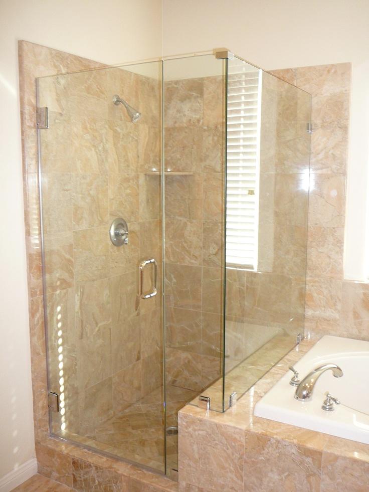 custom frameless 90 shower enclosure with a notch panel