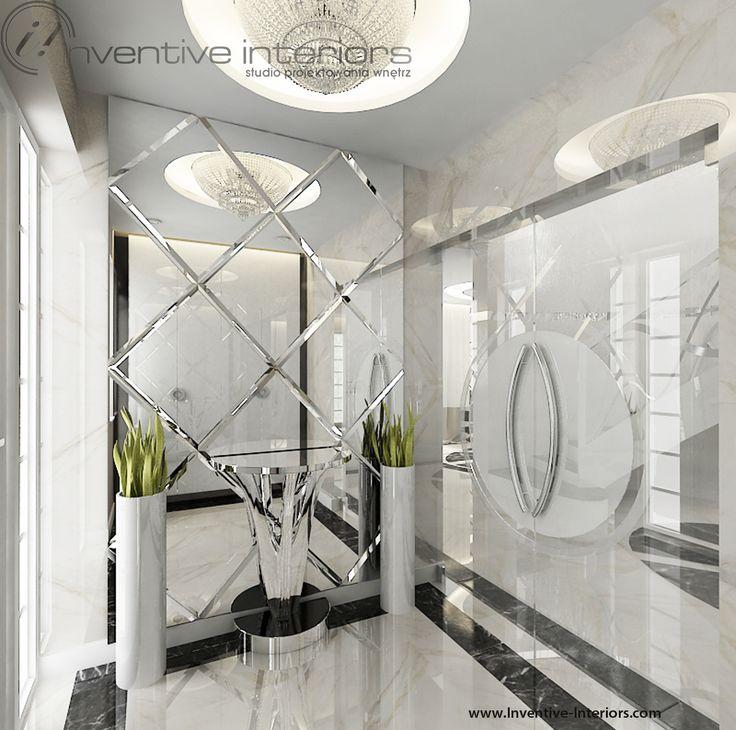 Projekt wiatrołapu Inventive Interiors - luksusowy wiatrołap z ciętym lustrem i żyrandolem
