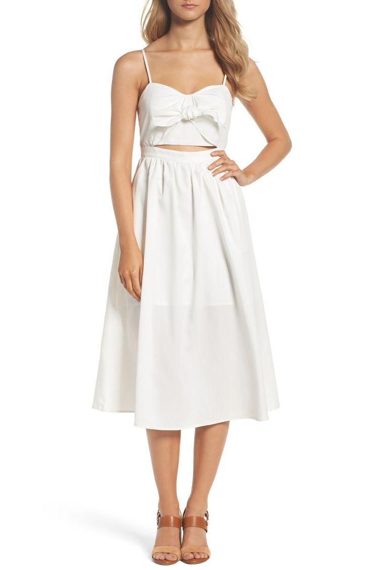 Ties at the bust and a flirty keyhole temper the summery appeal of this soft sundress sweetly finished with a flowy, midi-length skirt.