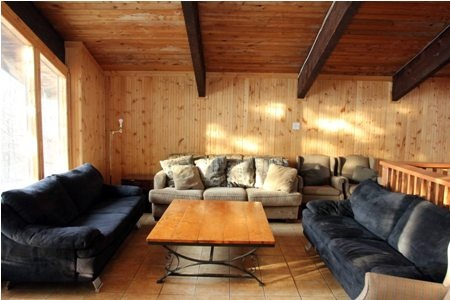 A classic seven bedroom Swiss Style Chalet that sleeps twenty people and offers a private hot tub and a woodburning fireplace