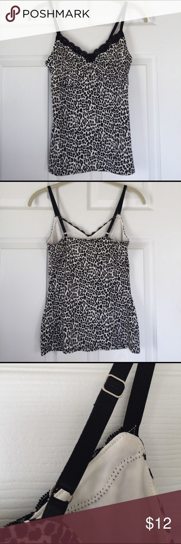 White House Black Market Animal Print Cami WHBM stretch cami has a black & gray animal print on a white ground and black lace trim. Adjustable straps, silky feel. Perfect under a cardi or even a denim jacket. Worn once if at all so still like new. Hand wash. White House Black Market Tops Camisoles