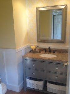 Powder room $100 makeover...board and batten, painted vanity, Target wallpaper