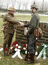 British and German descendants of Great War veterans, in period uniforms, shake hands at the unveiling of a memorial to the truce on 11 November 2008 in Frelinghien, France