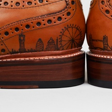 """London Skyline Shoe Tattoo"": Using a real tattoo gun and ink, the artisans at this London-based custom shoe shop make these beautiful brogues even more cool.  