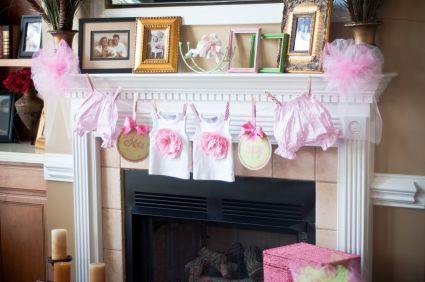 pink and white baby shower ideas | Love the pretty clothesline with cute little baby clothes hung from it